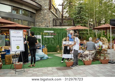 Mammoth Lakes, California - July 12, 2019: People Gather At A Booth At The Mammoth Food & Wine Exper
