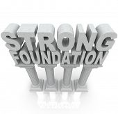 The words Strong Foundation atop large granite or marble columns to symbolize strength, resilience, dependibility and a solid background poster