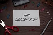 Handwriting text writing Job Description. Concept meaning a formal account of an employee s is responsibilities Scissors and writing equipments plus plain sheet above textured backdrop. poster