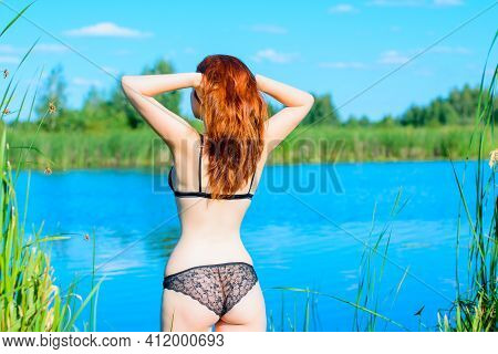 Mermaid Young Woman Naked With Red Hair On A Blue Lake . Sexy Plus Size Figure, Full Hips Pale Skin.