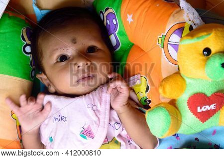 Close Up Portrait Of Cute Sweet Infant Toddler Feeling Wonder And Amazed About Surrounding Environme