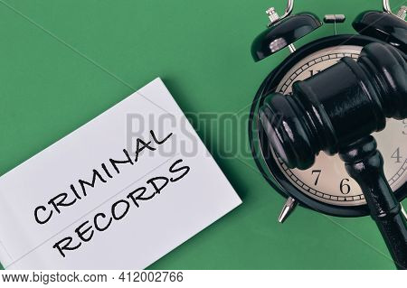 Clock, Judge Gavel And White Paper Written With Criminal Records