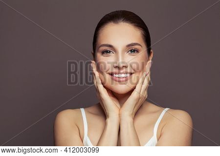 Happy Young Woman Spa Model With Clear Skin Smiling On Brown Background. Skincare And Facial Treatme