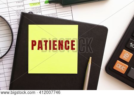 Patience Text On A Sticker On Your Desktop. Diary, Calculator And Pen. Financial Concept.
