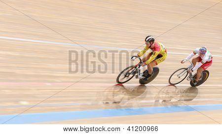 VIENNA,  AUSTRIA - SEPTEMBER 28  Tomas Babek (CzechRepublic) and  Miuchev Miroslav (Bulgaria) competes in the men's keirin event of an indoor cycling meeting on September 28, 2012 in Vienna, Austria.
