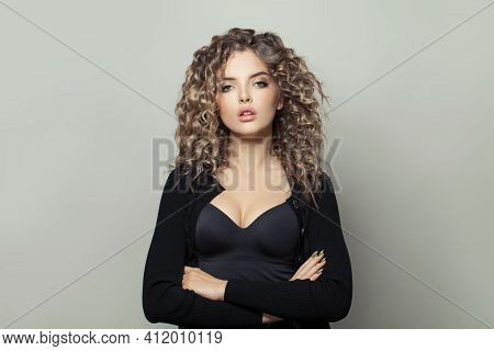 Perfect Woman With Crossed Arms On White Background