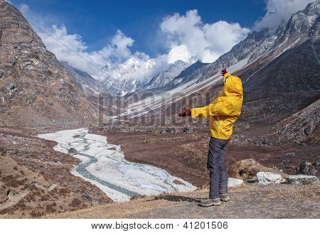 Human standing on rock and looking  mountains