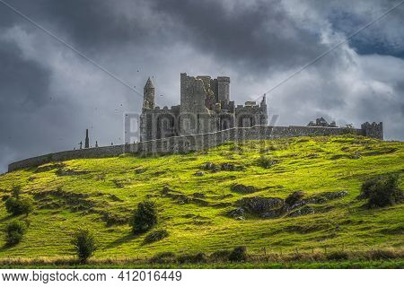 Majestic Castle, Rock Of Cashel, With Flying Crows Around The Tower And Dramatic Dark Storm Clouds I