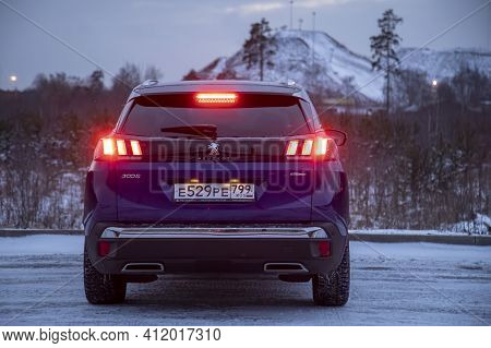 Moscow, Russia - March 15, 2020: Rear View Blue Suv Peugeot 3008 On On Winter Landscape. Rear Brake