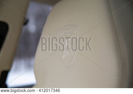 Moscow, Russia - December 15, 2020: Coat Of Arms Lamborghini Logo On The Headrest In Light Leather I