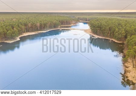 Water Reservoir. Breeding Ponds Located In Pine Forests. Among The Pines You Can Also See Deciduous