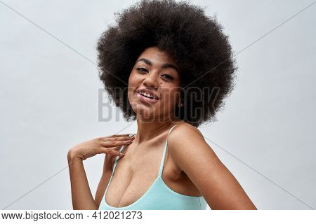 Portrait Of Sensual Voluptuous Young Woman With Afro Hair Style Wearing Blue Underwear Smiling At Ca