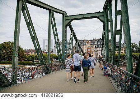 Historical Pedestrian Eiserner Steg, Iron Footbridge Over The Main River, Consists Of Riveted Steel