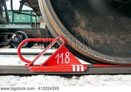 Brake Shoe Of Rail Wheel Of Train On The Rail. Winter Shoot. Close-up.