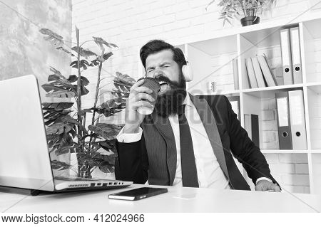 Singing Businessman. Businessman Sing Song At Workplace. Businessman Hold Coffee Cup As Microphone.