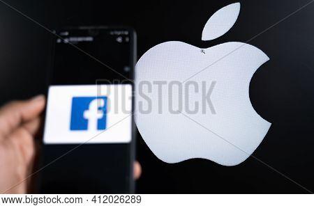 Maski, India 11,march 2021 : Selective Focus On Apple Logo, Facebook Social Media App On Phone And A