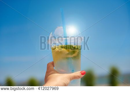 Cool Refreshing Lemonade In Hand. Woman Hold Ice Invigoration Summer Drink. Concept Quench Thirst
