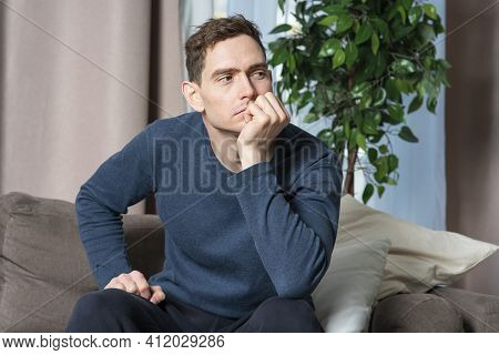 Portrait Of Serious Sad Upset Guy, Young Lonely Handsome Pensive Tired Bored Man Sitting At Sofa, Co