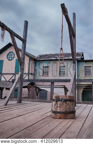 Place Of Execution Of Criminals In The Old Days-the Block And The Gallows On A Wooden Platform