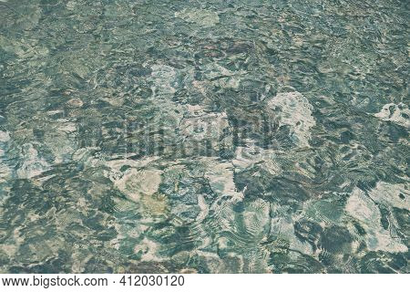 Clear Sea Water Texture, Top View Of The Rocky Bottom. Underwater View Of Sea Floor Bottom With Ston