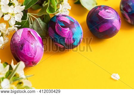 Easter Eggs Painted With Acrylic, A Sprig Of A Blooming Pear On A Yellow Background. Happy Easter. H