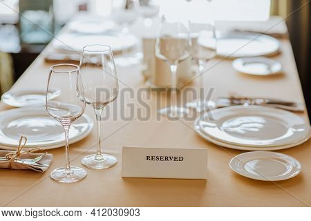 Lunch Tablecloth With White Plates, Glasses And Received Name Plate In Restaurant. Focus Is At Name