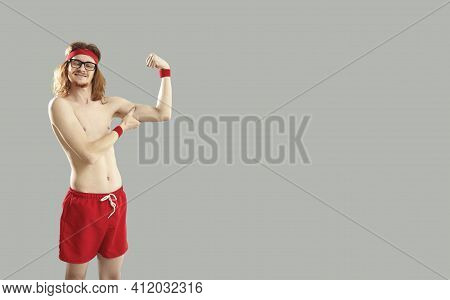 Funny Thin Young Guy In Red Shorts With Naked Torso Standing And Showing Small Biceps