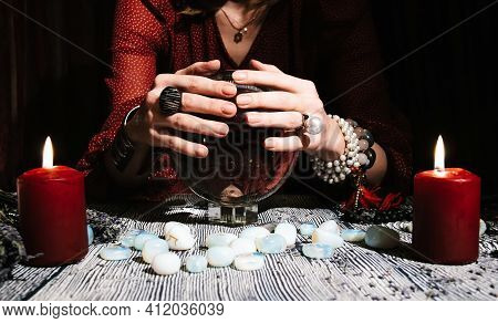 Fortunetellers Hands On A Glass Orb. Prediction Of The Future. Mystic Interior. Occult Symbols, Rune