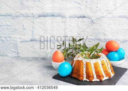 Easter Cake In Icing Sugar Painted Eggs On The Table. Copy Space