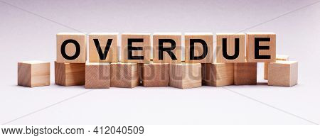 On A Light Background, Wooden Cubes With The Text Overdue