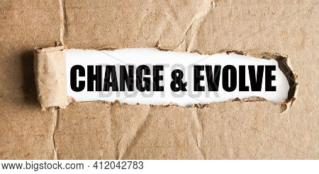 Change Evolve. Text On White Paper Over Torn Paper Background.
