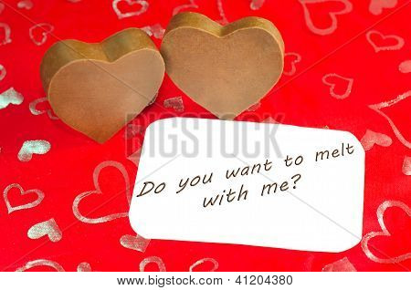 Two chocolate hearts with message.