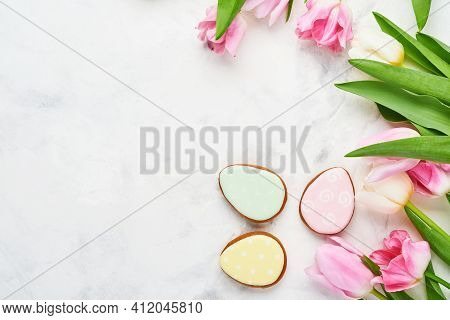 Easter Table Setting With Floral Decor And Plate With Easter Gingerbread On White Table. Elegance Di