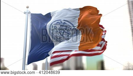 The Official Flag Of New York City Flapping Along With The American Stars And Stripes National Flag