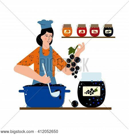 Joung Woman Is Making Jam Of Black Currant. Jar Of Delicious Jam In Glass Jar. A Saucepan Full Of Ja