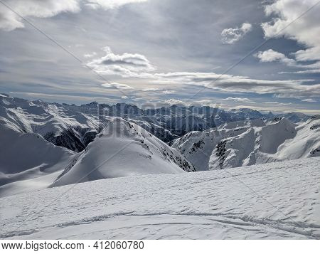 Skimo, Ski Mountaineering Above Goms In The Canton Of Valais With A View Of The Matterhon. Cloudy Da