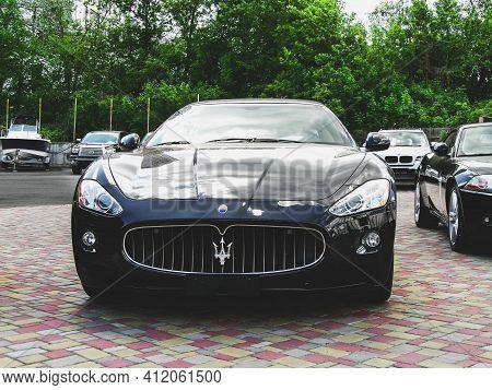 Kiev, Ukraine - May 14, 2011: Black Supercar Maserati Granturismo In The City