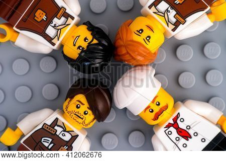 Tambov, Russian Federation - January 17, 2021 Four Lego Minifigures - Three Waiters And Chef Against