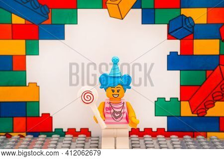 Tambov, Russian Federation - January 17, 2021 Lego Girl Blue Hair Minifigure With Lollipop Against C