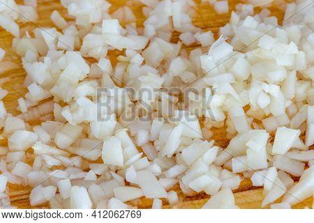 Finely Chopped Garlic. Macro Photo Of Small Garlic Cubes.