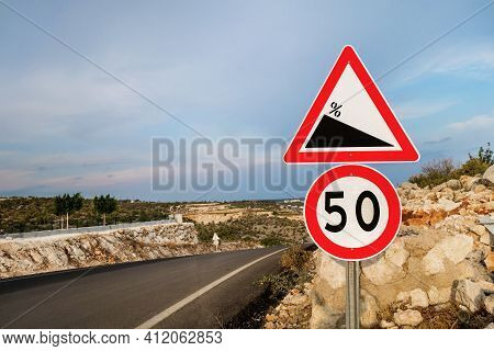 International Traffic Signs 'steep Descent' & 'speed Limit To 50 (kilometers Or Miles)'. They Are Lo