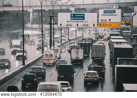 Moscow, Russia - January 28 2021: Two Ambulances With Flashing Lights On Rushing To Bypass Traffic J