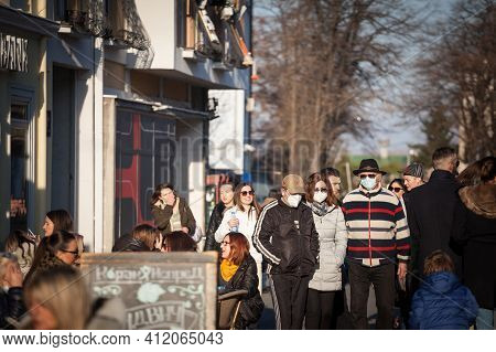 Belgrade, Serbia - February 21, 2021: People, Men And Women, Young And Old, Some Wearing A Face Mask
