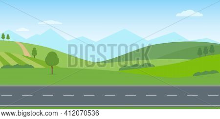 Straight Empty Road Through The Countryside. Green Hills, Blue Sky, Meadow And Mountains. Summer Lan