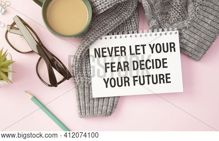 Never Let Your Fear Decide Your Future, Text Words Typography Written On Book Against Wooden Backgro