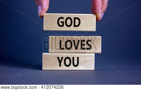 God Loves You Symbol. Concept Words 'god Loves You' On Wooden Blocks On A Beautiful Grey Background,
