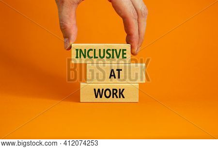 Inclusive At Work Symbol. Wooden Blocks With Words 'inclusive At Work' On Beautiful Orange Backgroun