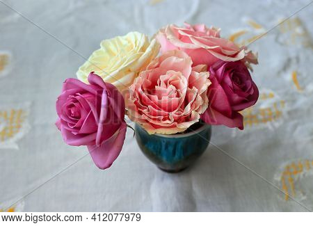 Delicate Small Bouquet Of Beautiful Colorful Roses On White Drapery