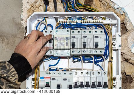 Connection Of Wires Against The Background Of A Wall In A House Under Construction. Twisting, Solder