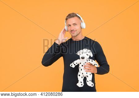 Technology Keeps Us Entertained. Childish Adult Listen To Music Playing With Toy Dog. New Technology